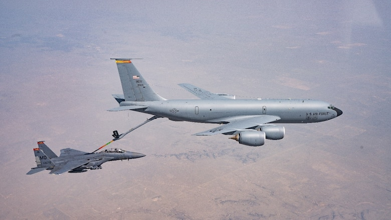An F-15E Strike Eagle from the 389th Fighter Squadron refuels with a KC-135 Stratotanker from Altus AFB, OK, over an air refueling track en route to Vance AFB, OK. (U.S. Air Force photo by Maj. Mark Calendine)