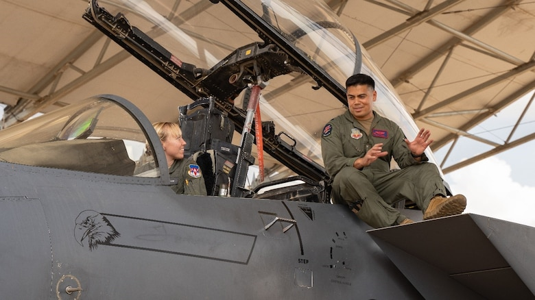 "Lt. Col. Roderick ""Brick"" James, 389th Fighter Squadron commander, speaks to a student pilot from the 71st Flying Training Wing at Vance AFB, OK. (U.S. Air Force photo by Maj. Mark Calendine)"