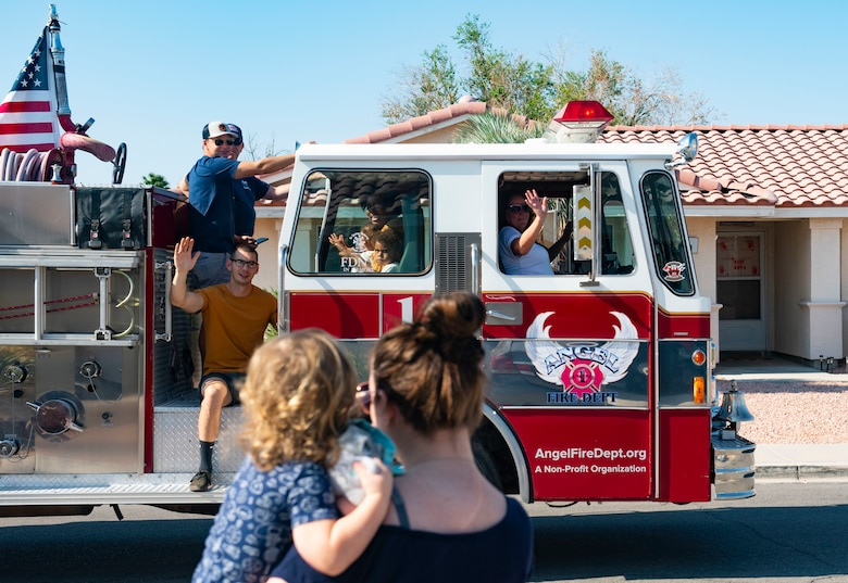 Family waves at firetruck.
