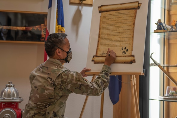 Staff Sgt. Jordan Elkins, 7th Civil Engineer Squadron fire inspector, right, reads a Fire Prevention Week proclamation to Col. Ed Sumangil, 7th Bomb Wing commander, at Dyess Air Force Base, Texas, Oct. 5, 2020. Sumangil declared that the week will be dedicated to bringing awareness to common household fire hazards while educating the community of standard fire safety and prevention.  (U.S. Air Force photo by Airman 1st Class Colin Hollowell)