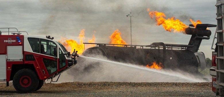 177th Civil Engineer Squadron firefighters participate in a live burn exercise during their annual training at Dover Air Force Base, Delaware, Sept. 17, 2020. Outside agencies depend on Dover AFB's resources to receive the proper annual training requirements that firefighters need to complete. (U.S. Air Force photo by Airman Brandan Hollis)