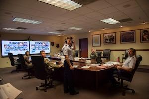 Airmen sit at virtual conference