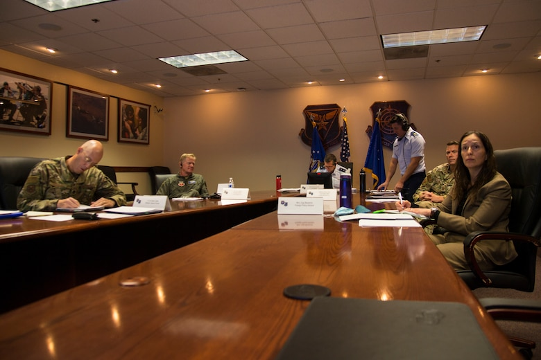 Air Force personnel participate in a virtual conference