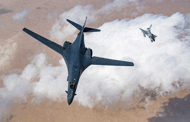 A U.S. Air Force B-1B Lancer bomber and a Qatari Mirage 2000 fly in formation during Joint Air Defense Exercise 19-01, Feb. 19, 2019. The aircraft participated with regional partners to test objective-based command and control actions during the exercise. (U.S. Air Force photo by Staff Sgt. Clayton Cupit)