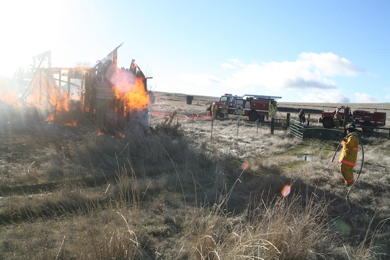 Jim Day puts out a structural fire during a training exercise as part of his volunteer fire fighting duties with High Prairie Fire and Rescue.