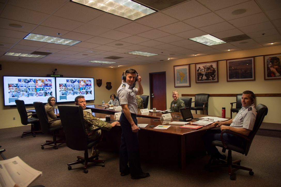 Airmen sit at virtual conference