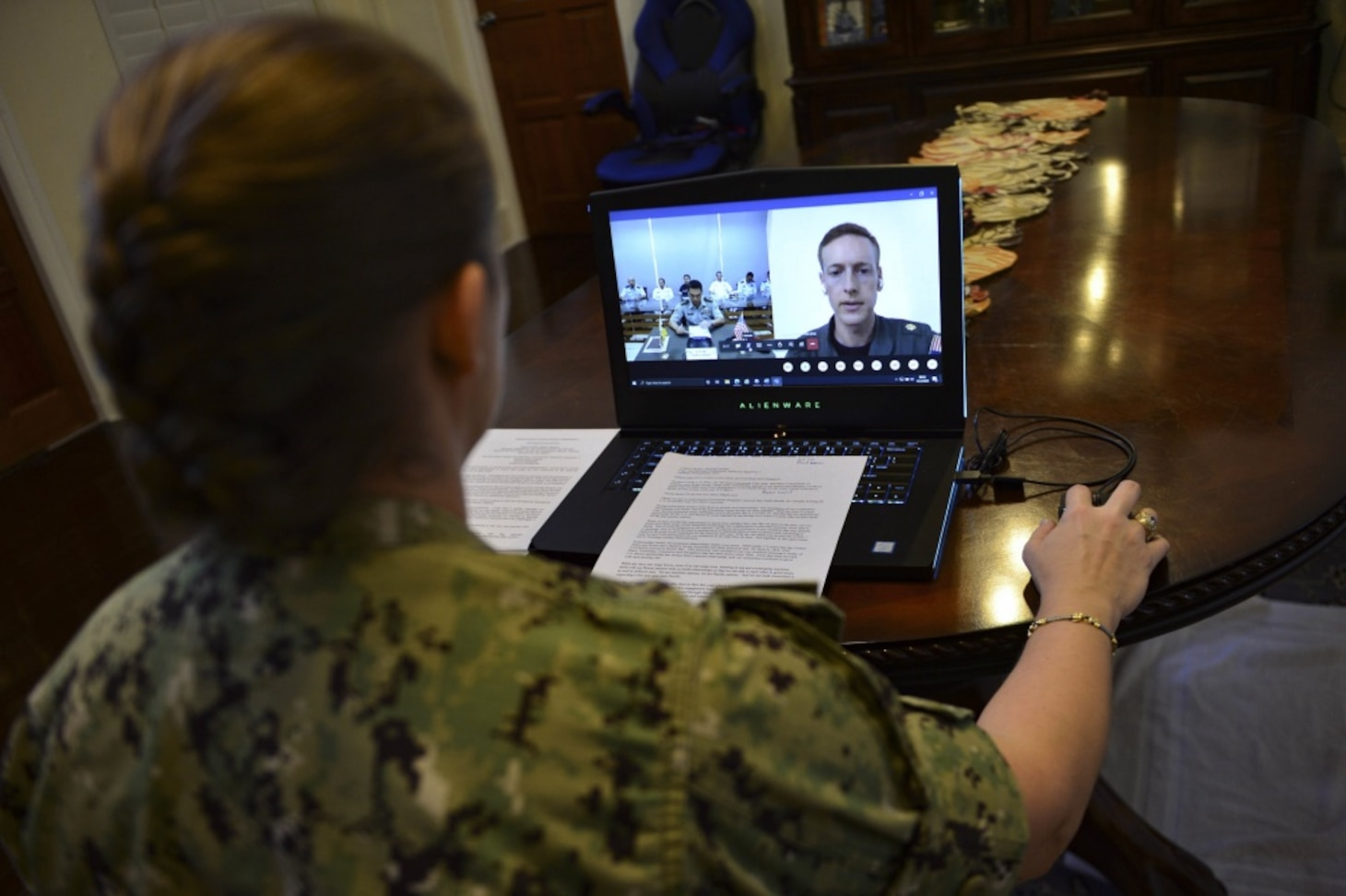 SINGAPORE (Oct. 5, 2020) – Capt. Ann McCann, commodore of Destroyer Squadron 7, listens to opening remarks during a virtual opening ceremony for Cooperation Afloat Readiness and Training (CARAT) Brunei 2020. 2020 marks the 26th iteration of CARAT, a multinational exercise designed to enhance U.S. and partner navies' abilities to operate together in response to traditional and non-traditional maritime security challenges in the Indo-Pacific region.