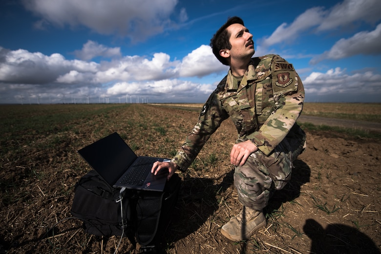 Photo of Airman forecasting weather in a field