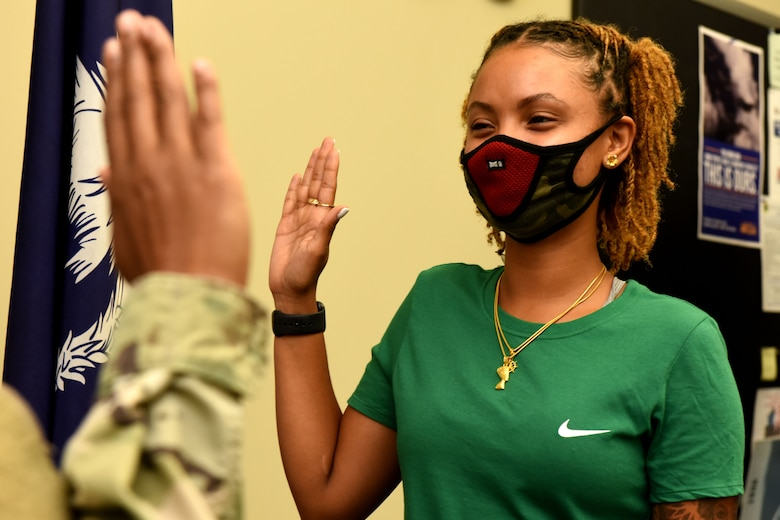 Oniyah Meadows, a new recruit for the South Carolina Air National Guard, performs her enlistment into the South Carolina Air National Guard's 169th Fighter Wing at the Joint Armed Forces Reserve Center on McEntire Joint National Base, August 19, 2020. Due to COVID-19, the recruitment and retention team of the South Carolina Air National guard have converted to a more virtual approach to recruits and participate in the proper health and safety precautions when interacting face-to-face. (U.S. Air National Guard photo by Senior Airman Mackenzie Bacalzo)