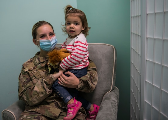 U.S. Air Force Senior Airman Bailey Miller, an imagery analyst with the 1st Special Operations Support Squadron, and her daughter spend time in the 1st SOSS nursing room at Hurlburt Field, Florida, Sept. 29, 2020. Approximately 14 units on Hurlburt have designated safe, clean and private spaces for family rooms to support Air Commandos and their families with plans to establish more soon. (U.S. Air Force photo by Airman 1st Class Robyn Hunsinger)