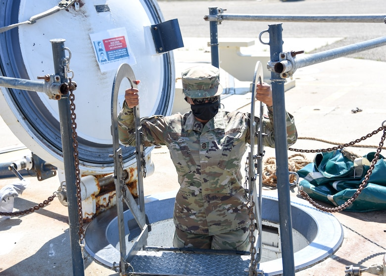 Chief Master Sgt. Diena Mosely, 82nd TRW command chief, climbs out of a missile silo