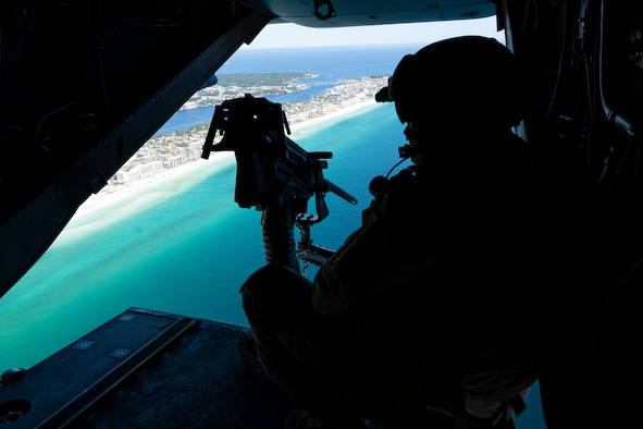 U.S. Air Force Staff Sgt. Tyler Cameron, a special missions aviator assigned to the 8th Special Operations Squadron, scans the horizon as a CV-22B Osprey tiltrotor aircraft flies above the Emerald Coast of Florida, Sept. 30, 2020. The Osprey combines the vertical takeoff, landing and hover capabilities of a helicopter with the long-range, fuel efficient and speed characteristics of a turboprop aircraft. (U.S. Air Force photo by Staff Sgt. Joseph Pick)