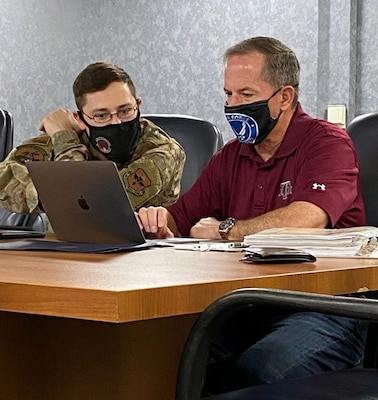 Retired Gen. David L. Goldfein, the 21st Chief of Staff of the U.S. Air Force, goes over paperwork with Tech. Sgt. Steven Daniels from the 502nd Comptroller Squadron Sept. 30. A command pilot with more than 4,200 flight hours, Goldfein served 37 years in the Air Force and is retiring to the San Antonio area.