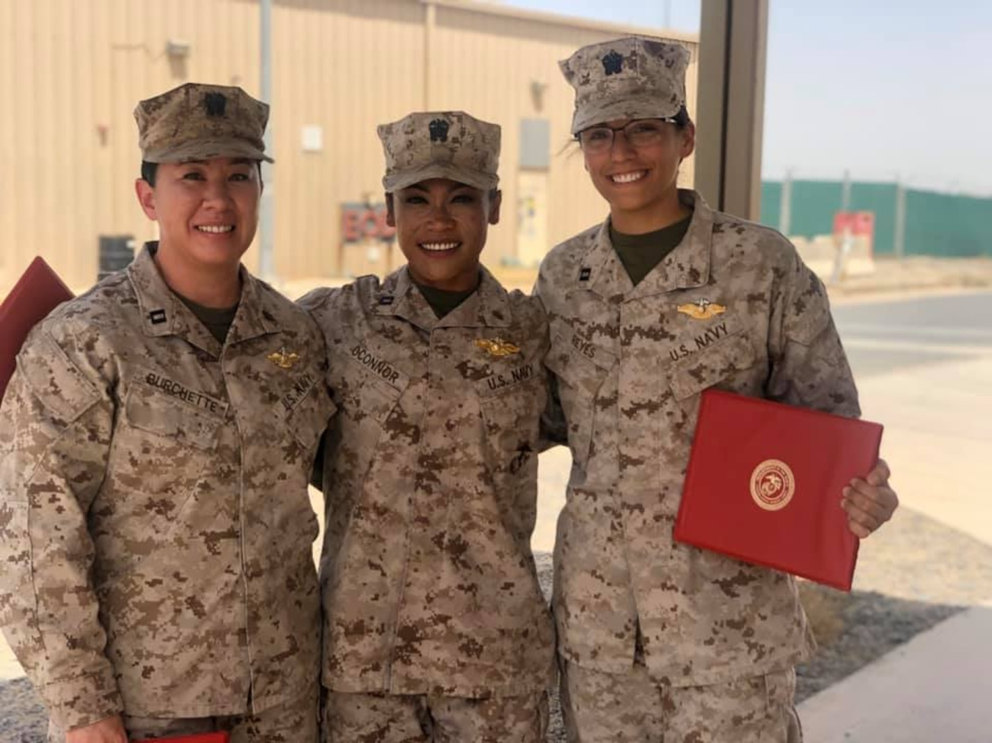 US Navy Sailor, Lieutenant Burchette, Lieutenant OConnor, and Lieutenant Reyes from Combat Logistics Detachment 27,SPMAGTF CR-CC, are awarded their Fleet Marine Force pins after undergoing an arduous evaluation on Marine Corps customs and traditions, professional knowledge, and history on May 20, 2020.
