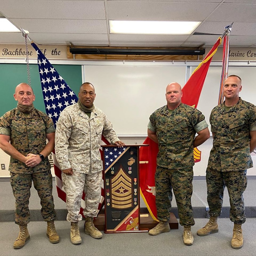 Sergeant Major Jabari Patton is congratulated during his retirement ceremony day by Sergeant Major Callahan, Sergeant Major Lopez, and Sergeant Major Reed on Marine Corps Base Cam Pendleton Calif. May 19,2020.