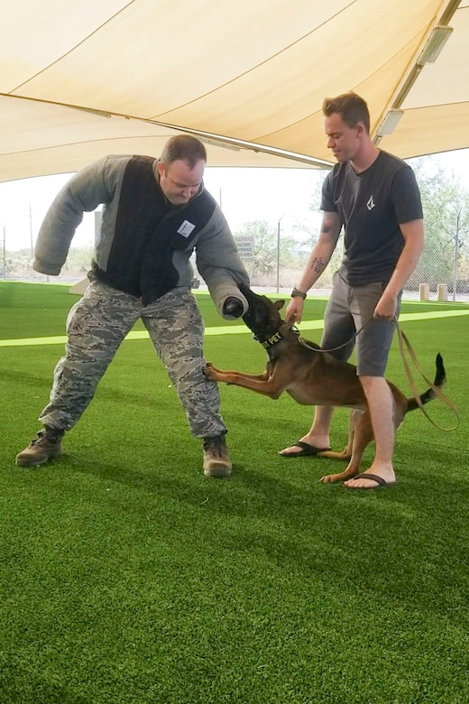 Chaplain (Capt.) Joshua Stevens, left, took part in a canine demonstration after he blessed military working dogs at Davis-Monthan Air Force Base, Ariz., during a temporary duty tour there in September 2020.
