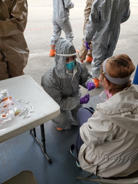 Maj. Lori Wyatt, 167th Medical Group assistant chief nurse, provides COVID-19 testing. Wyatt has been supporting community testing events throughout the pandemic and is the 167th Airlift Wing Airman Spotlight for the month of October 2020.