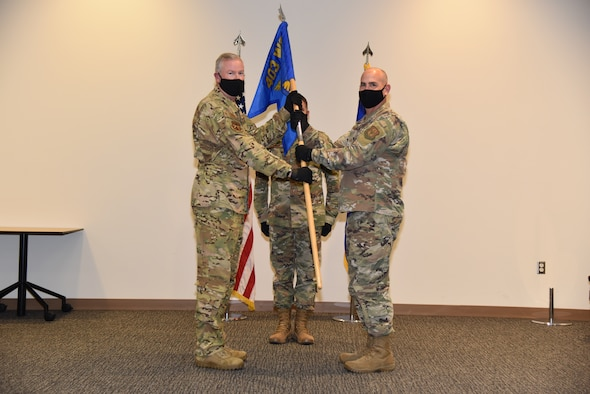 Col. Jeffrey A. Van Dootingh, 403rd Wing commander passes the guidon of the 403rd Maintenance Group to the incoming commander, Lt. Col. Steven W. Fortson, who  assumed command of the 403rd Maintenance Group, October 4, 2020 in the Roberts Consolidated Maintenance Facility Auditorium, Keesler Air Force Base, Miss. The 403rd MXG is responsible for the launch, recovery and routine care of 10 C-130J and 10 WC-130J Super Hercules aircraft in support of tactical airlift missions and the only Department of Defense aerial weather reconnaissance mission. (U.S. Air Force photo by Tech. Sgt. Michael Farrar)