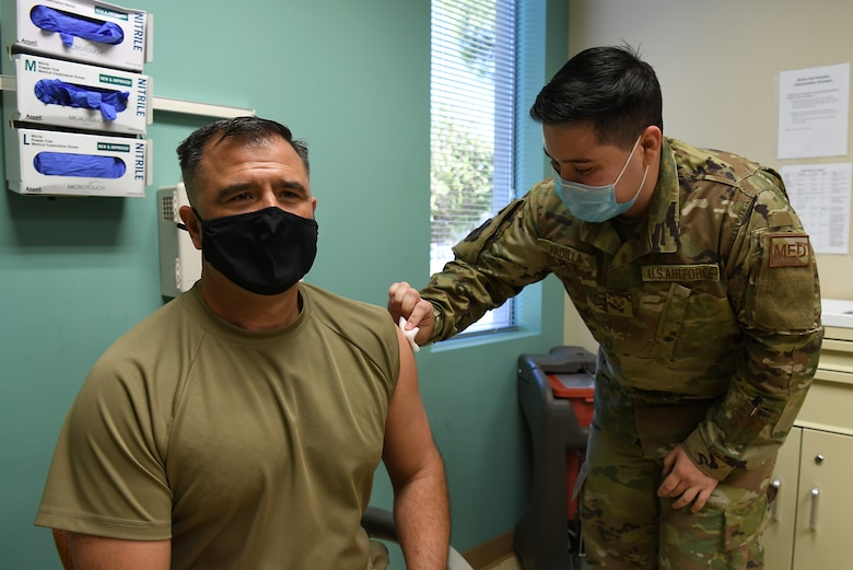 Senior Robert Padilla, 30th Health Care Operations Squadron aerospace medical technician, gives Col. Anthony Mastalir, 30th Space Wing commander, his annual flu shot Sept. 25, 2020, at Vandenberg Air Force Base, Calif.