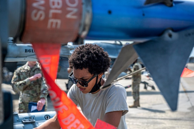 An Airman inspects munitions during a load crew competition.