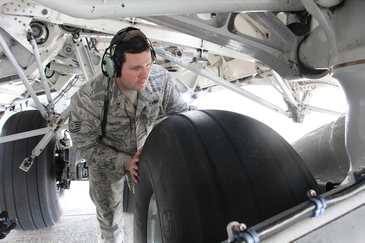 Tech. Sgt. Adam Grover of the 172d Airlift Wing's Maintenance Squadron inspects the tires of a C-17 Globemaster prior to a flight from the Combat Readiness Training Center, January 18, 2019. Southern Strike 19  is a total force, multi-service training exercise hosted by the Mississippi Air National Guard's Combat Readiness Training Center in Gulfport, Miss., and Camp Shelby Joint Forces Training Center near Hattiesburg, Miss., from Jan. 15 through Jan. 30, 2019. The exercise emphasizes air-to-air, air-to-ground and special operations forces training opportunities.  (A. Danielle Thomas, U.S. Air National Guard)