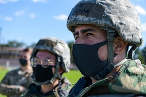 Senior Airman Cristobal Lopez, 374th Force Support listens to instruction during a decontamination brief at the squadron's war fighting training day.