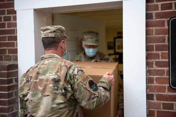 Staff Sgt. William Wood and Chief Master Sgt. Roland Shambaugh deliver personal protective equipment to the Morgan County Health Department, Berkeley Springs, W.Va., Sept. 29, 2020.