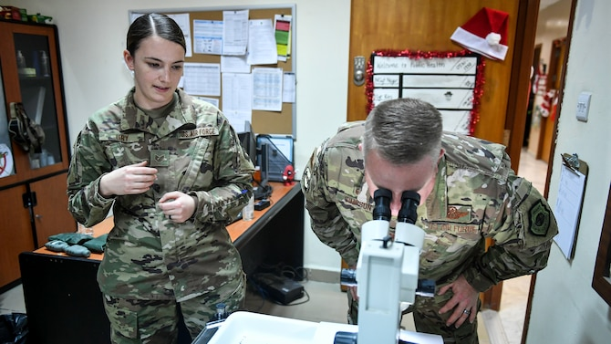 Image of U.S. Air Force Staff Sgt. Shannon Ury, 386th Air Expeditionary Wing Public Health Technician, with Col. Rod Simpson, 386th Air Expeditionary Wing commander.