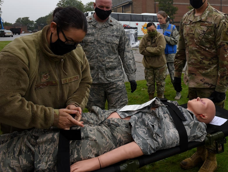 An Airman assigned to the 48th Fighter Wing Medical Group secures a medical simulation manikin during Mission Assurance Exercise 20-20 at Royal Air Force Feltwell, England, Sept. 29, 2020. During the exercise, medical personnel received unique training and challenged their proficiency, practicing medical skills and procedures while treating simulated injuries in a forward operating location. (U.S. Air Force photo by Airman 1st Class Rhonda Smith)