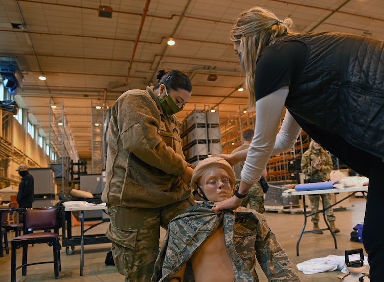Tech. Sgt. Angela Kim, emergency medical service program manager at the 48th Medical Group, prepares a medical simulation manikin for Mission Assurance Exercise 20-20 at Royal Air Force Feltwell, England, Sept. 29, 2020. During the exercise, medical personnel received unique training and challenged their proficiency, practicing medical skills and procedures while treating simulated injuries in a forward operating location. (U.S. Air Force photo by Airman 1st Class Rhonda Smith)