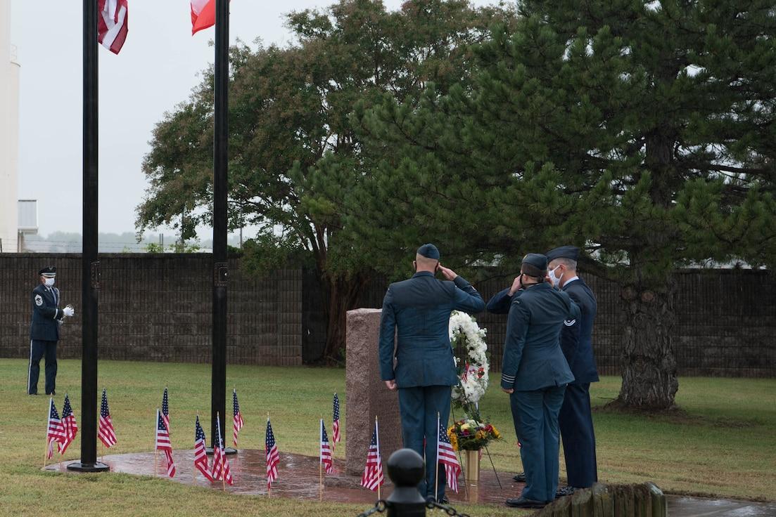 552 ACW Airmen laying wreath