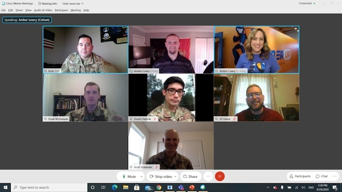 Volunteers in the 42nd Cyberspace Operations Squadron meet with CyberUp representatives Sept. 29, 2020, Scott Air Force Base, Ill. (U.S. Air Force photo by Chief Master Sgt. Michael Jimenez)