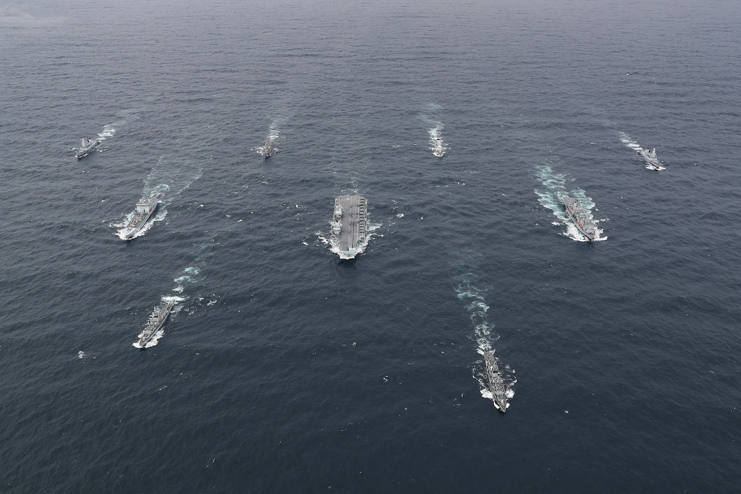 The full United Kingdom (UK) Carrier Strike Group (CSG) sails in formation for a photo exercise (PHOTOEX).