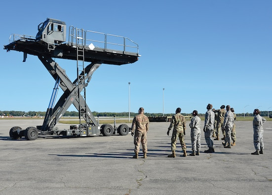Airmen from the 87th Aerial Port Squadron practice the operation of a Halvorsen Loader Sept. 19, 2020, at Wright-Patterson Air Force Base, Ohio. The Halvorsen Loader, which entered into service in 2001, is a rapidly deployable, high reach mechanized aircraft loader that can transport and lift up to 25,000 of cargo 18 feet into the air to be loaded onto civilian and military aircraft.
