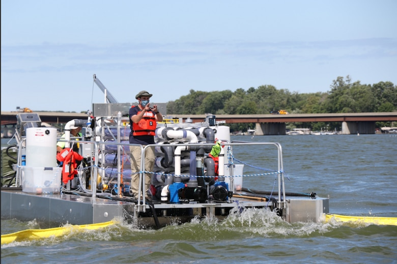 The U.S. Army Engineer Research and Development Center's (ERDC) Operational Water Research team leader, Dr. Martin Page, directs the lead boats during preliminary flow testing of a floating version of the Harmful Algal Bloom Interception Treatment and Transformation System. ERDC collaborated with New York State Department of Environmental Conservation scientists and industry partners to study harmful algal bloom mitigation technology in Chautauqua Lake, N.Y., from Aug. 19 through Sept. 4.