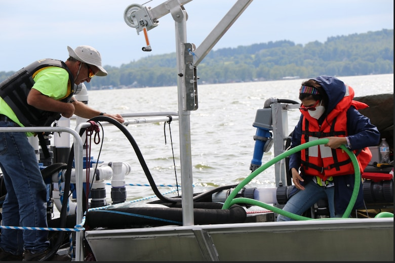 U.S. Army Engineer Research and Development Center (ERDC) researchers collect harmful algal bloom samples onboard the mobile dissolved air flotation system at Chautauqua Lake, N.Y. The ERDC Operational Water Research team collaborated with New York State Department of Environmental Conservation scientists and industry partners to study harmful algal bloom mitigation technology from Aug. 19 through Sept. 4 in Chautauqua Lake.
