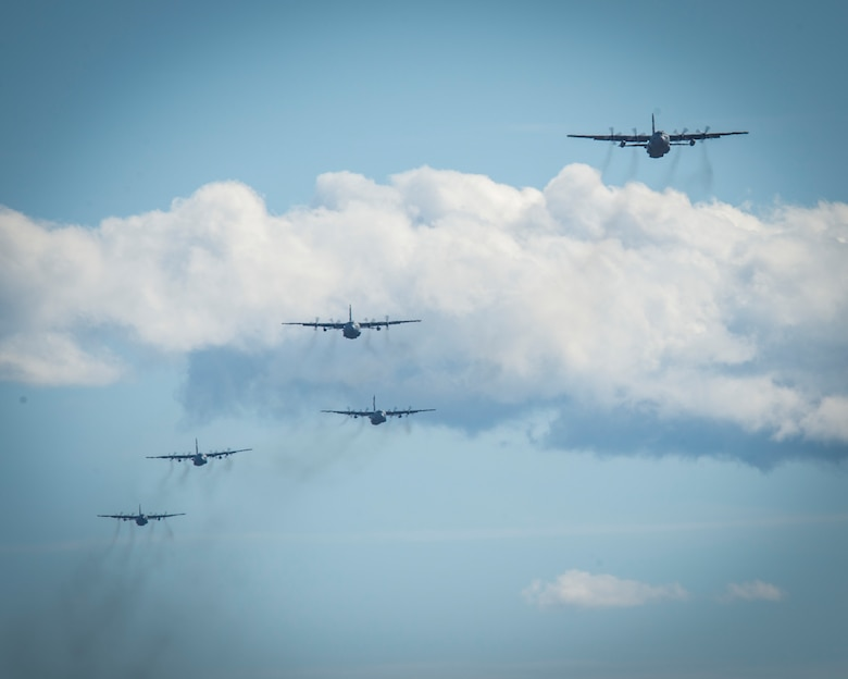 """Five C-130H Hercules aircraft assigned to the 103rd Airlift Wing fly over Westover Air Reserve Base in Chicopee, Massachusetts, Oct. 4, 2020. The mission, known as a """"Max Fly,"""" challenges the unit to fly the maximum amount of aircraft in its fleet in a single mission, and is a comprehensive display of the unit's readiness and tactical airlift capabilities. (U.S. Air National Guard photo by Staff Sgt. Steven Tucker)"""