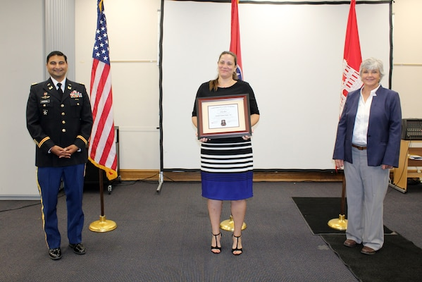 Sondra Abanto (Center), U.S. Army Corps of Engineers Nashville District, receives a certificate of completion for the 2020 Leadership Development Program Level I Course from Lt. Col. Sonny B. Avichal, Nashville District commander, and Patricia Coffey, deputy district engineer, during a graduation ceremony Sept. 10, 2020 at the Scarritt Bennett Center in Nashville, Tennessee. The district recently named Abanto the employee of the month for August 2020. (USACE photo by Mark Rankin)