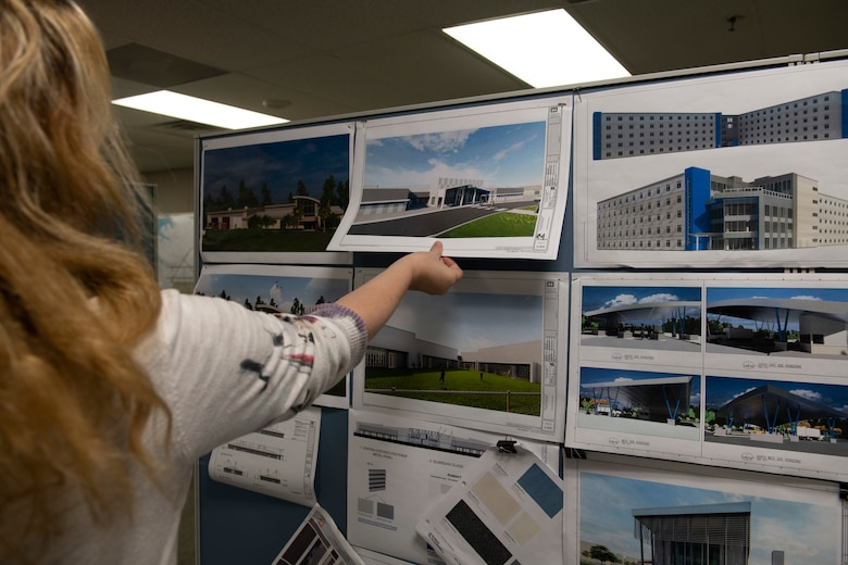 Woman shows pictures of future buildings