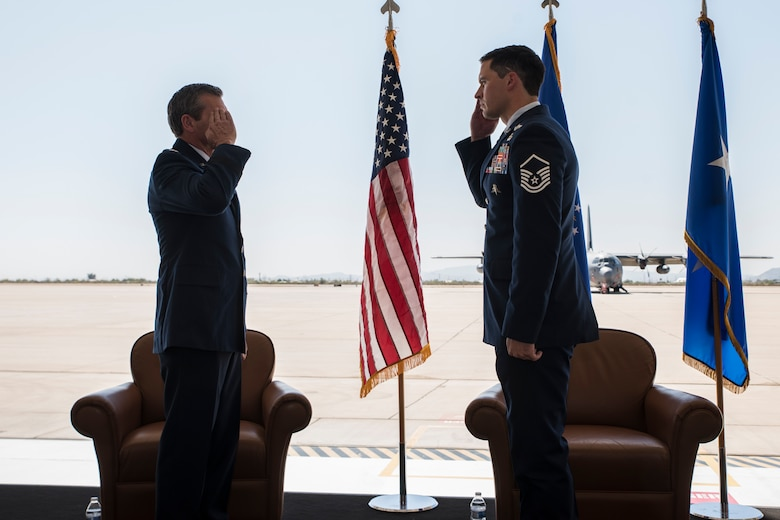 A photo of Airmen saluting during a medal presentation ceremony