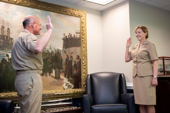 WASHINGTON (July 23, 2020) Vice Adm. Michelle Skubic, right, receives the Oath of Office from Adm. Mike Gilday, chief of naval operations, during a promotion ceremony at the Pentagon. Skubic is the 20th Supply Corps officer to pin on three stars in the corps' 225 year history and is the first woman to do so. (U.S. Navy photo by Mass Communication Specialist 1st Class Raymond D. Diaz III/Released)