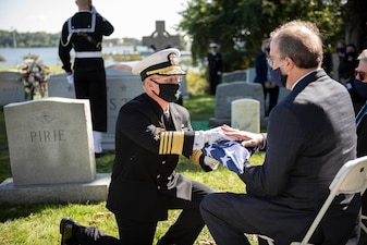 ANNAPOLIS, Md. (Oct. 5, 2020) Chief of Naval Operations Adm. Mike Gilday (CNO) presents an American flag to the son of the late Adm. Carlisle A. H. Trost during a funeral in his honor. Trost, a native of Illinois, served as the 23rd CNO from June 30, 1986, until June 29, 1990. (U.S. Navy photo by Mass Communication Specialist 1st Class Raymond D. Diaz III/Released)