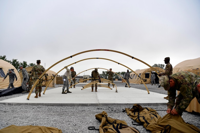 Airmen from the 434th Civil Engineer Squadron set up tents on Grissom Air Reserve Base, September 10, 2020. Airmen from the 434th Civil Engineer Squadron recently put their training to the test, setting up a bare base with 24 tents, in roughly 10 hours.
