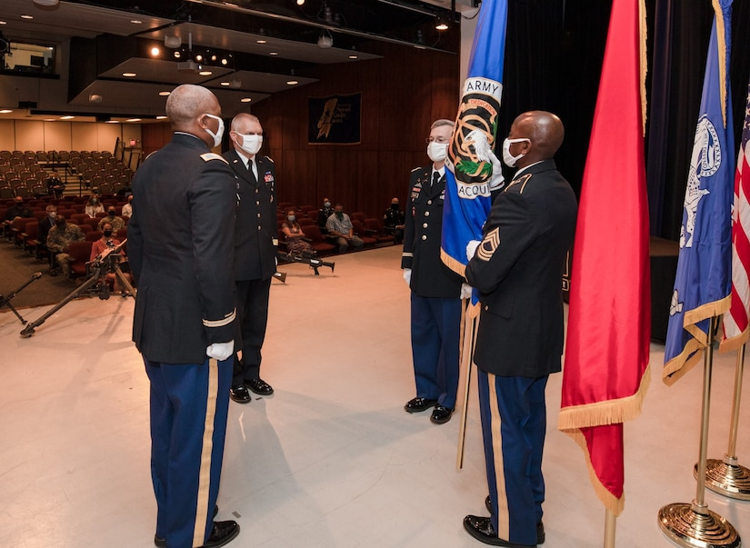 Col. Elliott R. Caggins, Brig. Gen. Vincent F. Malone II, Col. Scott J. Madore and MSgt. Willie D. Richardson (l-r) prepare to pass the Acquisition flag during Project Manager Soldier Lethality's July 10 Change of Charter Ceremony at Picatinny Arsenal, N.J.  Col. Malone replaced Col. Caggins who retired from the Army after 30 years of service.