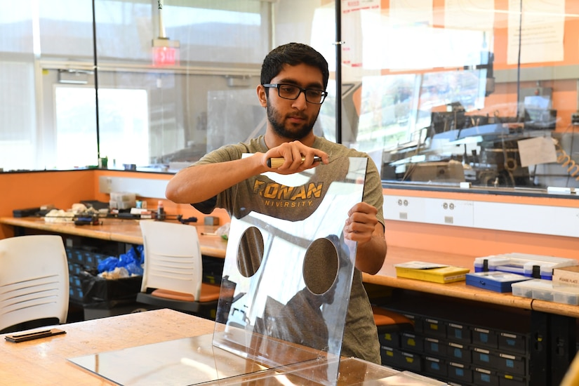 Kunj Parmar, son of Shailesh Parmar and former PM SL summer engineering intern, smooths the side panel edge of one of the intubation boxes he and his Rowan University roommates fabricated to help protect the state's health care workers. The students and their professor were recognized publicly in April by N.J. Governor Phil Murphy for helping to protect the state's health care workers.