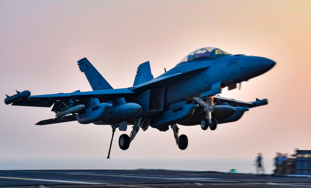 "ARABIAN GULF (Oct. 6, 2020) An E/A-18G Growler, from the ""Cougars"" of Electronic Attack Squadron (VAQ) 139, makes an arrested gear landing on the flight deck aboard the aircraft carrier USS Nimitz (CVN 68) in support of Operation Inherent Resolve. Nimitz, the flagship of Nimitz Carrier Strike Group, is deployed to the U.S. 5th Fleet area of operations, conducting missions in support of OIR, and maritime security operations alongside regional and coalition partners. (U.S. Navy photo by Mass Communication Specialist 3rd Class Cheyenne Geletka)"