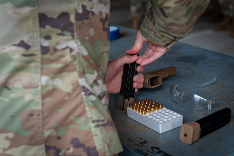 Photo of an Airman loading ammo into a magazine