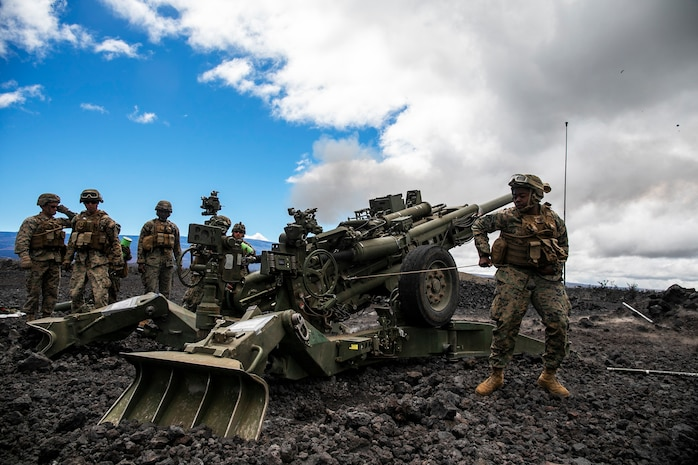 U.S. Marine Corps Pfc. Cameron White,  a cannoneer with Charlie Battery, 1st Battalion, 12th Marine Regiment, pulls the lanyard of an M777A2 Howitzer duringan artillery raid aboard Pohakuloa Training Area, Hawaii, Sept. 25, 2020. The training event, supported by Marine Medium Tiltrotor Squadron 363, Marine Heavy Helicopter Squadron 463, and Combat Logistics Battalion 3 was a part of Spartan Fury, a training exercise that aims to strengthen 1/12's expeditionary readiness and tactical proficiency. (U.S. Marine Corps photo by Sgt. Luke Kuennen)