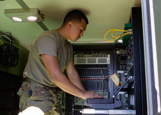 Airman David Jasso,726th Air Control Squadron radio frequency transmission technician, configures radio frequency for air-to-ground communications inside a Radio Unit - 214 (RU-214), Sept. 30, 2020, at Grasmere Range, Idaho. The 726 ACS use the RU-214 to transmit communications during live exercise and operations. (U.S. Air Force photo by Staff Sgt. Tyrell Hall)