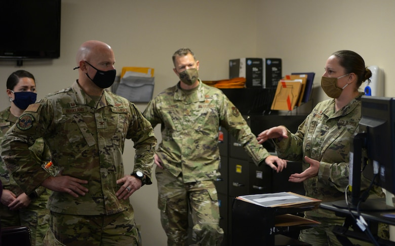 U.S. Air Force Col. David Berkland, left, the 354th Fighter Wing  commander, and Chief Master Sgt. John Lokken, center, the 354th FW command chief, speak with Lt. Col. Heather Wempe, the 354th Force Support Squadron commander during a wing leadership immersion on Eielson Air Force Base, Alaska, Oct. 6, 2020. Berkland visited the force support squadron to personally connect with Airmen and see how their roles contribute to Eielson's overall mission. (U.S. Air Force photo by Senior Airman Beaux Hebert)